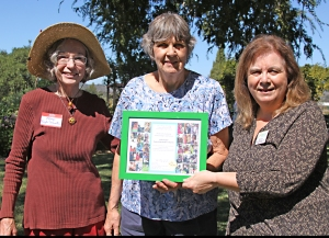 Mary Blom and Vi Moir accepted a Certificate of Appreciation from Heifer Project International's Community Engagement Director for our partnership and support in their work on world hunger.
